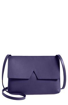 "Loving the notched ""V"" detailing at the flap nods of this sleek purple crossbody bag. @nordstrom #nordstrom"