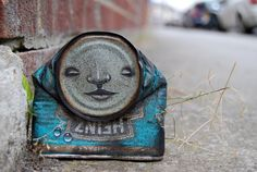 Street artist My Dog Sighs paints faces on found cans and leaves the artworks on the street for people to find.
