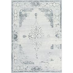 Featuring an elegant scrolling design in gray, this weathered rug inspires timeworn appeal in your living room or master suite.  Pro...