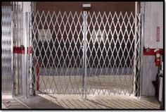 Warehouse Folding Security Scissor Gates Add Visability & Lets Fresh Air Circulate Your Commercial Warehouse Or Building