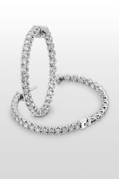 Veronique - A pair of hoop earrings with endless amount of sparkle. A perfect accessory if you are going to a work event or attending a wedding!