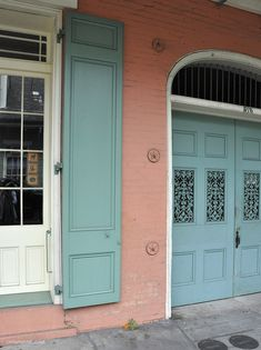 """royal st . a bright coral house . """"paris green"""" shutters . french quarter . new orleans"""