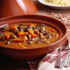 Tagine (tay-jean) is the name of savory Moroccan meat or poultry stews as well as the ceramic vessel in which they are cooked. A slow cooker creates the same kind of moist, gentle cooking as the ceramic tagine.