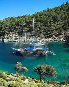 A secluded bay in the Turkish Mediterranean, with two traditional gulet pleasure boats.