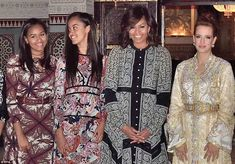 The Obamas (from left, Sasha, Malia and their mother Michelle) donned traditional patterned outfits to dine with Morocco's Princess Lalla Salma (right) in Marrakesh on Tuesday evening