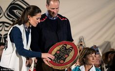 William and Kate were given a drum for Prince George, pictured, during their visit...