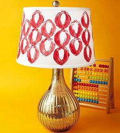 Use a halved onion to add a mod pattern to your a plain lampshade.