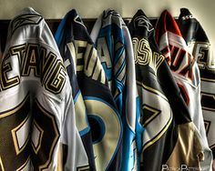 This would be a neat, decorative way to hang up jerseys. Show your pride- don't hide them in your closet!