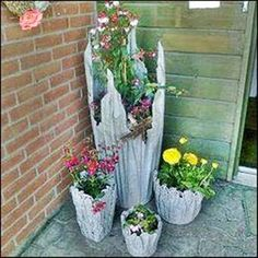 Britches ..... says: Interesting flower pots garden