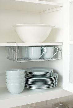 Some great kitchen organizing ideas from Martha Stewart like using a wire inbox for under-shelf storage.