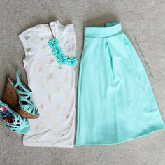 gold foil pineapple print top with mint skirt and mint flower necklace
