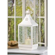White Wrought Iron Lantern with Ivy Motif Glass Panels.