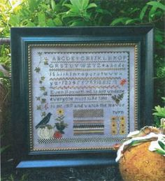 Autumn Garden is the title of this cross stitch pattern from Samplers Not Forgotten - love the crow sitting on the pumpkin and the sunflower...