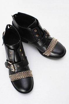 Boots crafted in PU, featuring a round toe, gold-tone hardwares, multi curb chain detail to front, pin buckle detail to foot strap and back counter, stitching to the main, with a treaded rubber sole and a high block heel.