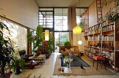 I love open living spaces. And bookshelves. And plants on bookshelves.
