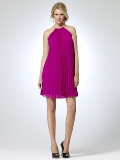 Trapeze style accordion pleated dress with adjustable length snake chain neck. Lobster clasp closure. 36 inch body length Dress and lining: 100% polyesterDomesticDry clean only