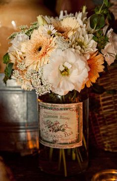 Love the softness of the colors,flowers, and use of vintage advertising label.