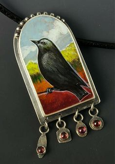 "Sarah J.G. Wauzynski: Black Bird, Necklace in sterling silver, egg tempera, and rhodolite garnets, on an 18"" leather cord. Pendant measures ..."