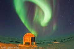 Mike Theiss' photo of the northern lights from the North Pole sign on 12/10/12.
