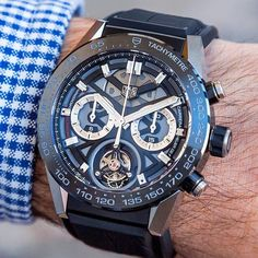 Tagheuer Carrera Heuer-02T a COSC-certified automatic chronograph combined with a titanium and carbon flying tourbillon. | #beautifulmenswatches | @rabatwatches