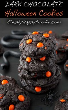 Dark Chocolate Halloween Cookies make a creepy and tasty treat! The dark as night chocolate cookies are the perfect spooky backdrop for pumpkin orange candies. Serve these chocolate Halloween cookies at your party, or gift them to friends & neighbors to say Happy Halloween! simplyhappyfoodie.com