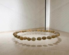 This is wonderful!  A circle made from floating rocks; it's simple, contemplative and simply beautiful.  By Ken Unsworth.