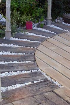 A few days ago we showed you a garden path made from recycled timber and pebbles.  Here is a curved version to consider.