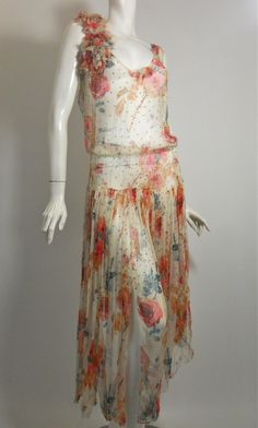 1920s sheer silk chiffon pink floral dress with dots of rhinestones, floral bouquet with rhinestone and velvet centers at shoulder.