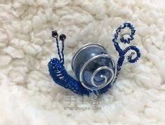 Snail wrapped bead