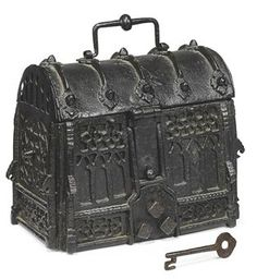 A SPANISH WROUGHT-IRON DOMED CASKET LATE 15TH OR EARLY 16TH CENTURY The body with pierced architectural decoration; the front with a hasp, concealed lock and working iron key; some oxidisation to the metal mounts; later black-painted surface