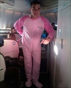 Robbie Williams in a giant pink sleeper suit. I love this man.