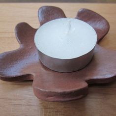 Hey, I found this really awesome Etsy listing at https://www.etsy.com/listing/96225076/wavy-terracotta-flower-tea-light-holder