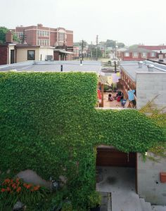 6 Amazing Facade Makeovers. A wide cut across the top of an old factory building in Torontomade room for a second-floor courtyard where its residentscan catch some sun but maintain their privacy. On the ground level, the front door is tucked into an ivy-covered alcove lined with ipe, a material used throughout the house.