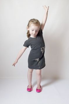 make a girl's dress out of a woman's tee---bring the neck in to the right size (front & back), then adjust arm holes to smaller sleeves.