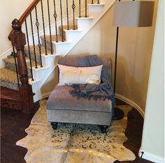 Jennifer Gentile from Texas shares a photo of this 5X5 feet gold metallic cowhide rug with us. What a nice way to decorate this small corner. Congratulations and thanks for sharing the photo with us.