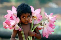 Little boy selling flowers in India.
