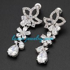 Unique brass alloy earrings decorated with flower of cubic zirconia