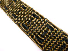 A bracelet pattern made with one drop even peyote stitch using 11/0 Miyuki delica beads in 2 colors. Length: 7.13in (18,1cm) Width: 1.16in (2,9cm) The PDF file includes: 1. The pattern design 2. A bead legend - bead numbers and colors needed 3. A large, detailed, numbered graph of