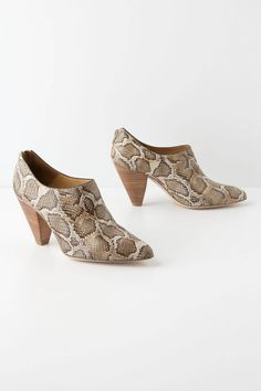 """- Fits true to size - Back zip - Leather upper, insole, sole - 3"""" stacked leather heel - Spain"""