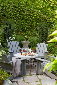 A tiny front yard becomes a pocket paradise, a walled courtyard with graystone pavers, a fountain, Adirondack chairs, and a marble-and-iron table. Design Myra Hoefer this would be cool in backyard Small Outdoor Patios, Small Patio, Outdoor Rooms, Outdoor Dining, Outdoor Gardens, Outdoor Decor, Outdoor Seating, Backyard Seating, Pocket Garden Small Spaces