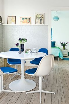 very cool apartment from Denmark.  I love the floors, colors, and the globe pendant light in the bedroom