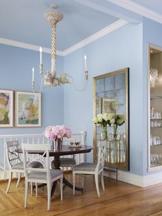 For smaller south-facing rooms, paint both the walls and ceiling with the same shade of blue. This will cut down on the contrast and make your room appear larger.  Try: Skylark 530A-2 by Behr