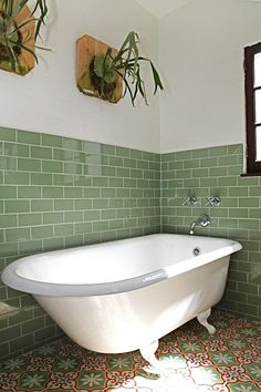 this green subway tile and that bathtub. Bathroom Plants, Boho Bathroom, Bathroom Renos, Bathroom Flooring, Bathroom Wall, Small Bathroom, Bathroom Green, Retro Bathrooms, Bathroom Remodeling