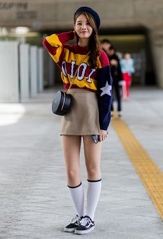 Fashion Week goer wearing beret, oversized knit and A-line skirt, knee-high socks and Vans trainers at Seoul Fashion Week | ASOS Fashion & Beauty Feed