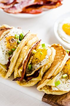 Breakfast tacos - Light and fluffy pancakes act as a vehicle for thick slices of bacon, melted cheese, and fried eggs. Smother the whole thing in maple syrup and you have the best breakfast ever! Clean Eating Breakfast, Breakfast Tacos, Breakfast Time, Best Breakfast, Breakfast Recipes, Breakfast Ideas, Irish Breakfast, Gourmet Breakfast, Breakfast Sandwiches