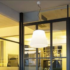 """VULCANONE OUT A pendant light that erupts its brilliant """"flame"""" upwards and shower down a deluge of light"""