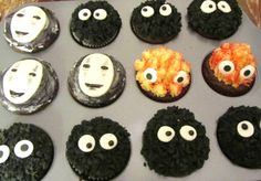Cupcakes based on Studio Ghibli characters: Noface, Calcifer and soot sprites.  From the movies Spirited Away, Howl's Moving Castle, and My Neighbor Totoro.