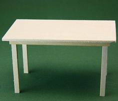 DIY instructions for a simple kitchen table in dolls house scale (ready for final sanding and finishing).