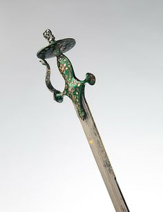 Saber (Tulwar) with Scabbard Date: blade, dated 1673; hilt, 19th century Culture: Indian Medium: Steel, silver, diamonds, enamel, leather Dimensions: Blade length, 31 1/2 in. (80.01 cm) Classification: Swords Credit Line: Bequest of George C. Stone, 1935 Accession Number: 36.25.1591a, b