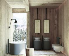 Bathroom furnished by Arcadia collection of CIELO. Cibele bathtub and Tiberino washbasin and Argo mirror